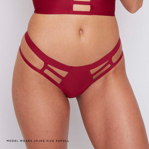 Caged wine red thong that has the planet in mind, made from soft, breathable recycled fabrics providing ultimate comfort and style.