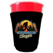 Load image into Gallery viewer, black partycup koozie with hide and seek champion design