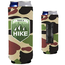 Load image into Gallery viewer, camo magnetic slim can koozie with take a hike text and mountain and tree graphic design