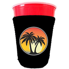 Load image into Gallery viewer, black party cup koozie with palm tree sunset design