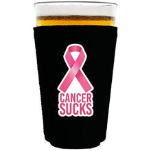 Load image into Gallery viewer, black pint glass koozie with cancer sucks text and pink ribbon graphic