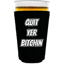 "Load image into Gallery viewer, black pint glass koozie with ""quit yer bitchin"" funny text design"