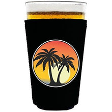 Load image into Gallery viewer, pint glass koozie with palm tree sunset design