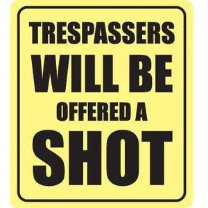 vinyl sticker with trespassers will be offered a shot design