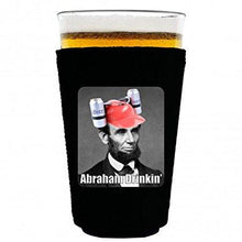 Load image into Gallery viewer, pint glass koozie with abraham drinking design
