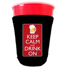 Load image into Gallery viewer, black party cup koozie with keep calm and drink on design
