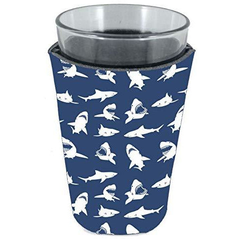 pint glass koozie with shark silhouettes in white on a navy background