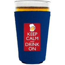 Load image into Gallery viewer, pint glass koozie with keep calm and drink on design