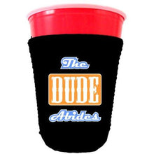 Load image into Gallery viewer, black party cup koozie with the dude abides design
