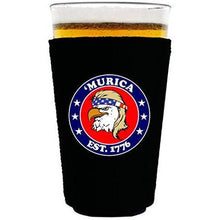 "Load image into Gallery viewer, black pint glass koozie with ""'Murica 1776"" logo and bald eagle mullet funny design"