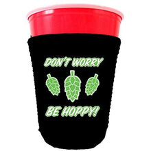 Load image into Gallery viewer, black party cup koozie with dont worry be hoppy design
