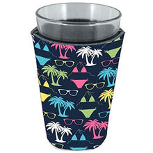Load image into Gallery viewer, pint glass koozie with bikini and sunglasses pattern on navy background