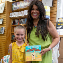 "Load image into Gallery viewer, Another author reading and signing event for ""Indy, Oh Indy: Pismo or Bust!"" — this time, at Petunia's Bookstore in Fresno. Here, Teresa Adamo had the honor of posing with her youngest granddaughter, Monroe Adamo, who happened to be celebrating her 7th birthday on the same day!"