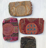 Back view of vintage textile clutches from India.