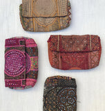 Front view of vintage textile clutches from India.