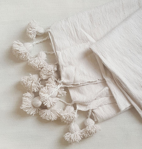CREME: organic cotton pom blanket