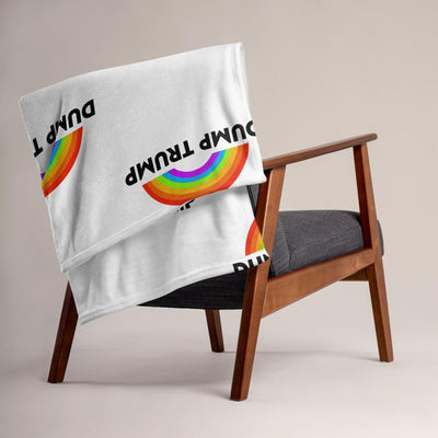 White throw blanket that says Dump Trump with drawing of rainbow