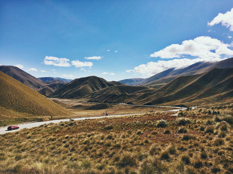 """Far from Help New Zealand Countryside Photo by <a href=""""https://unsplash.com/@cass4504?utm_source=unsplash&utm_medium=referral&utm_content=creditCopyText"""">Cassie Matias</a> on <a href=""""https://unsplash.com/s/photos/driving-new-zealand?utm_source=unsplash&utm_medium=referral&utm_content=creditCopyText"""">Unsplash</a>"""