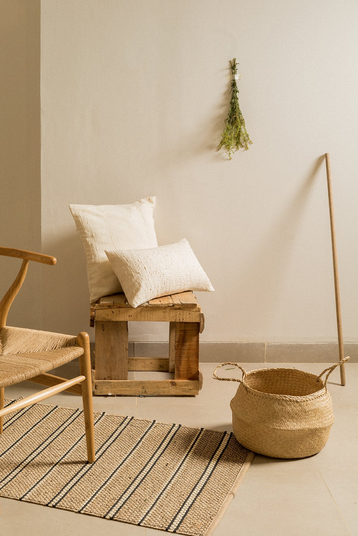 Handwoven white cotton slub pillows in nature-inspired living room with neutral colour palette.