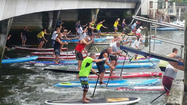 Paddle board racing under the Canopy Bridge