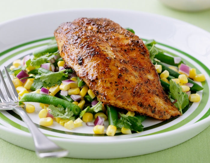 Cajun-spiced fish with fresh corn