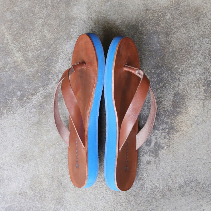 Blankens SS19. An environmental friendlier flipflop made from vegetable tanned leather on a blue sole. Handmade in Portugal from European leathers. Affordable luxury!