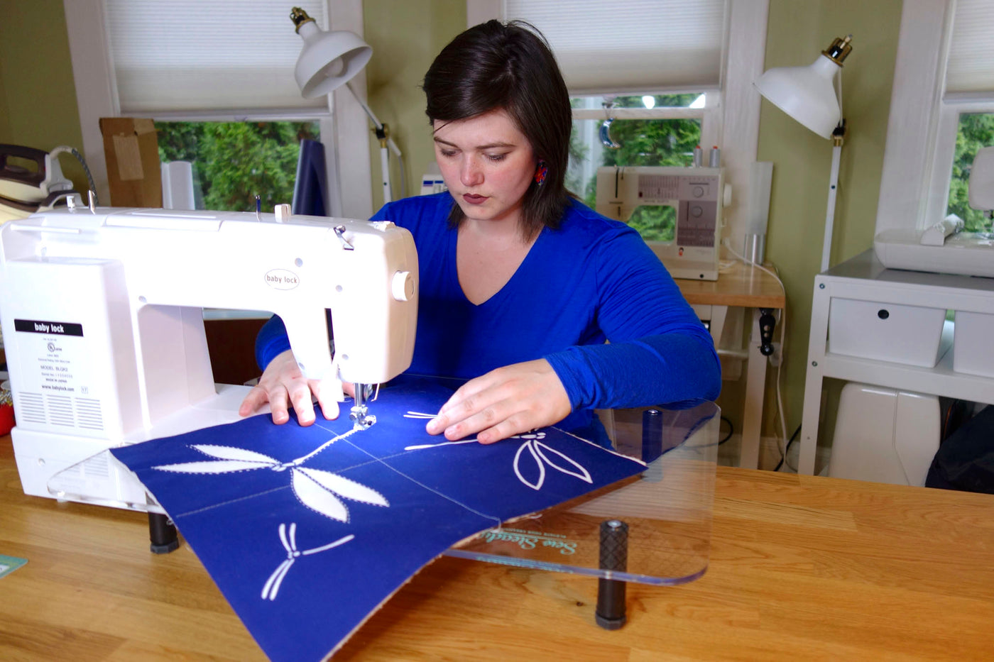Victoria Stone of Okan Arts stitches a practice quilt tile with the Baby Lock Sashiko 2 machine