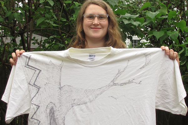 Josie Curry with a t-shirt for a Spirit Quilt to be made with her brother's clothes