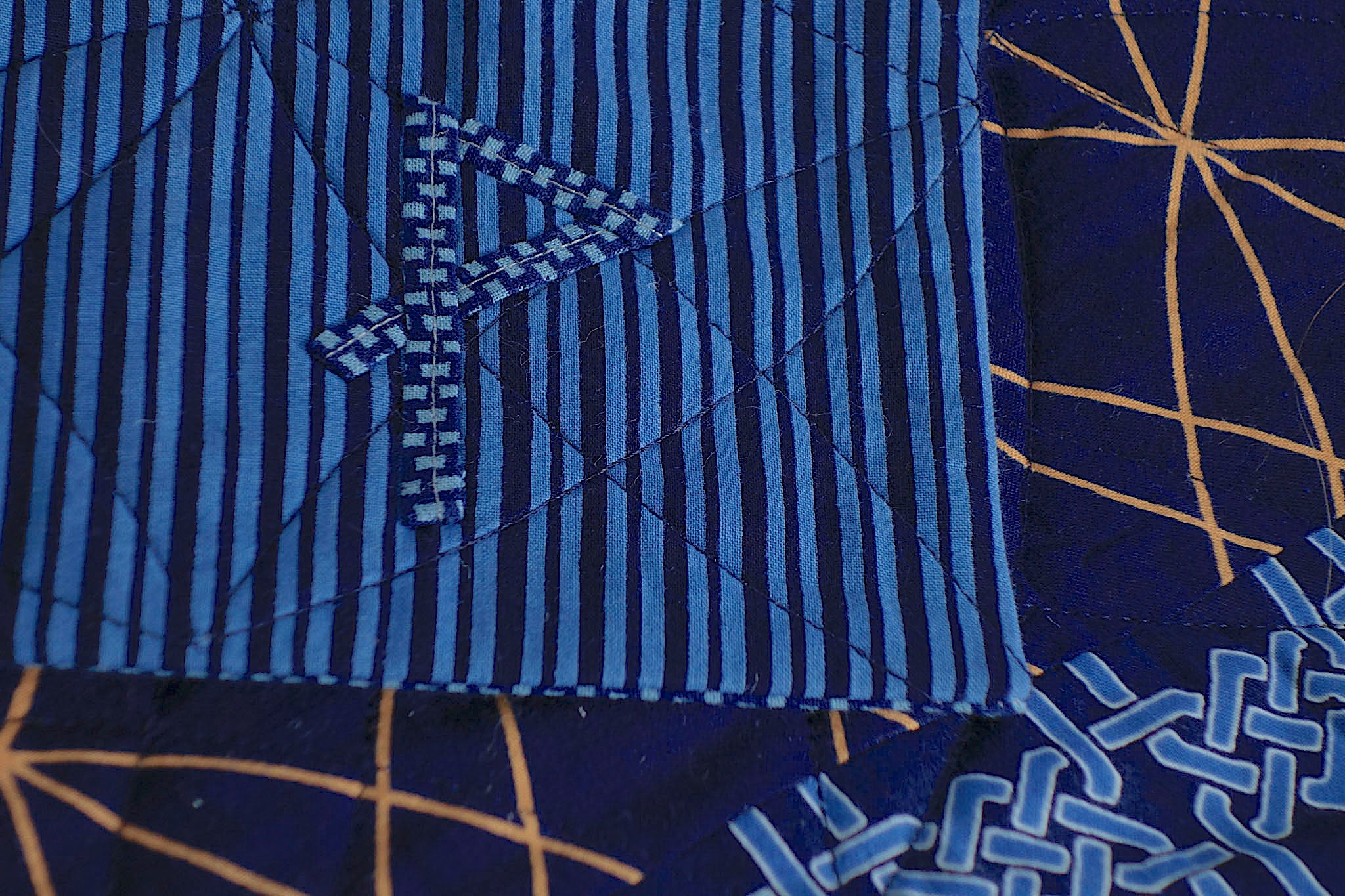 Signature on Indiglow, a king-size quilt by Patricia Belyea