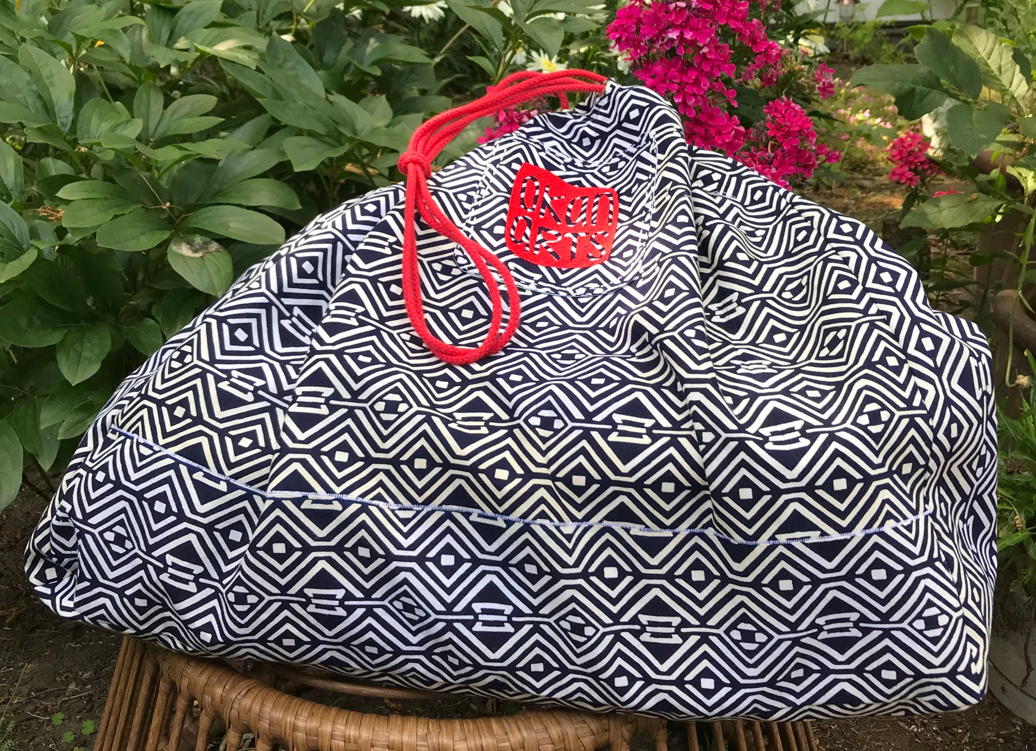Rice-bag-style sack for the delivery of Indiglow, a king-size quilt by Patricia Belyea