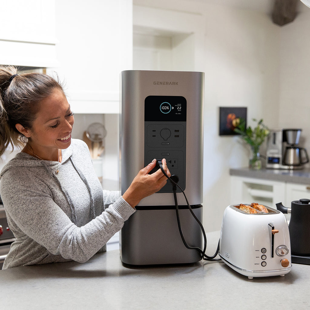 A woman plugs a toaster into the HomePower 2 portable power station for modern homes.