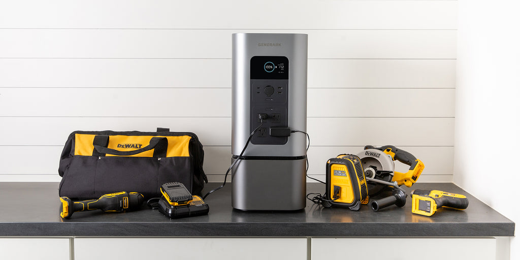 The HomePower 2 is on a counter with power tools plugged into it.