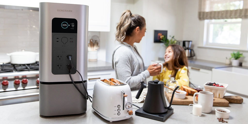 A woman and child use kitchen appliances powered by the HomePower 2.