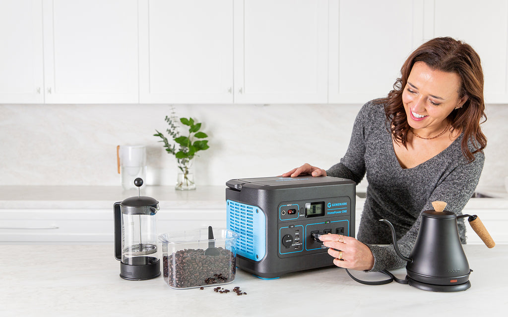 A woman plugs a kettle into the HomePower ONE portable power station.