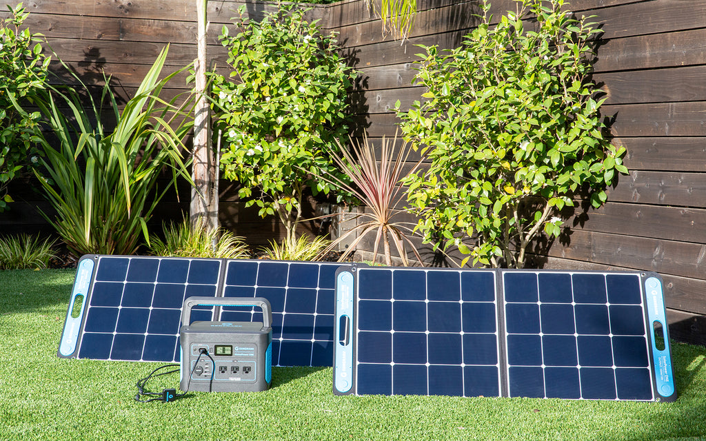 Generark's HomePower ONE portable power station and SolarPower ONE solar panel power station are pictured outdoors.