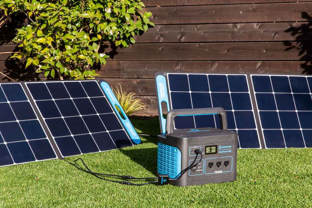 The HomePower ONE backup battery power station and SolarPower ONE solar panel power station are pictured on a lawn.