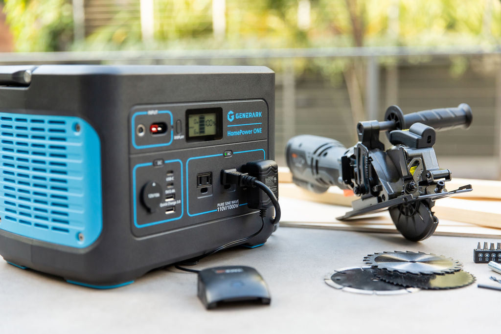The HomePower ONE is pictured on an outdoor workbench powering a saw.