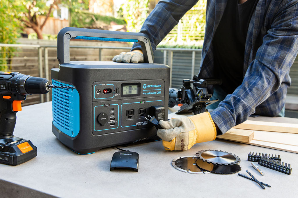 A man plugs a power tool into the HomePower ONE portable power station.