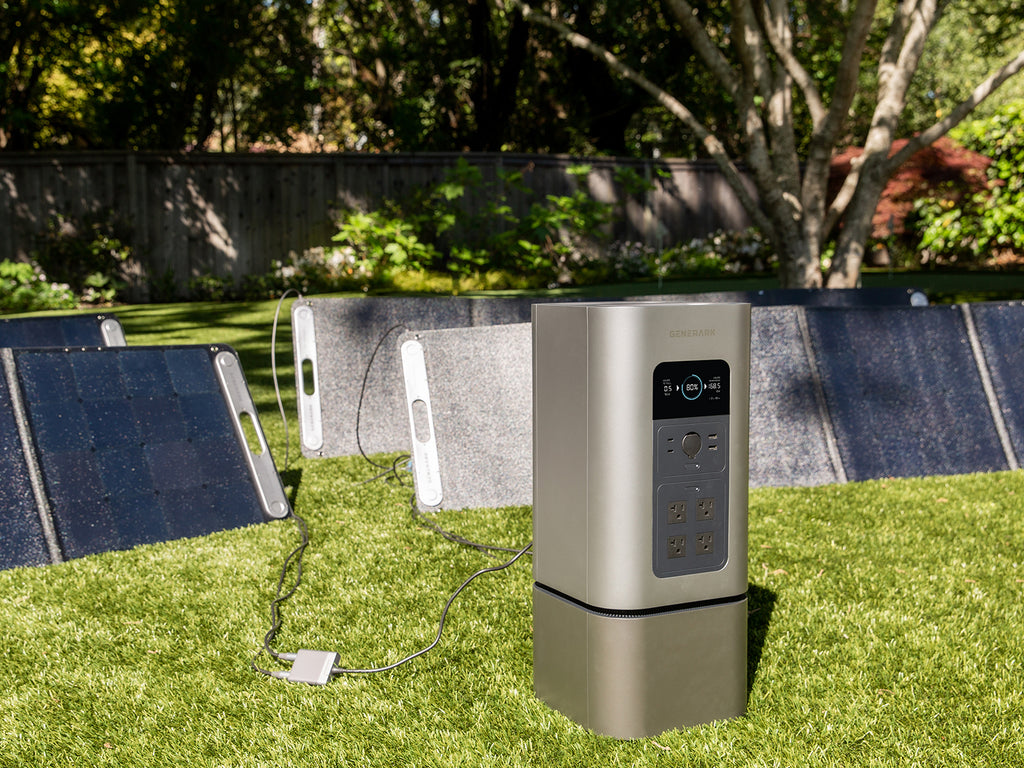 The HomePower 2 charged in a backyard from the SolarPower 2 solar panels.