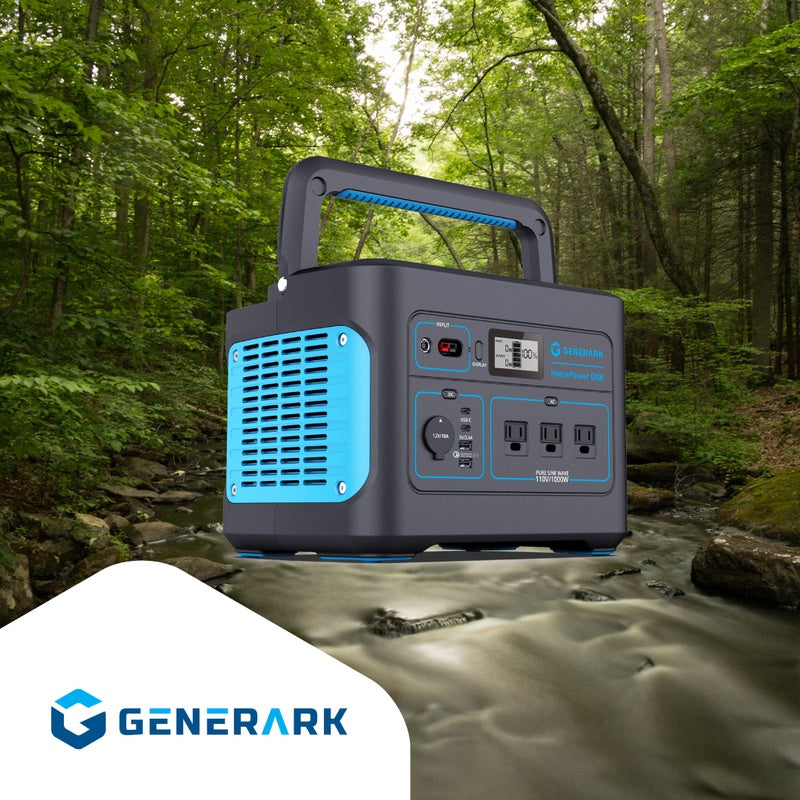 The HomePower ONE portable power station sits on a rock in a wooded area.