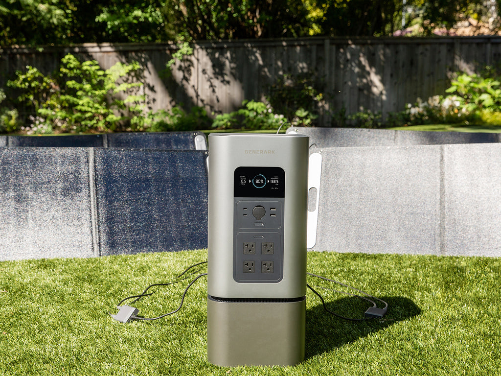 The HomePower 2 backup battery generator is pictured outdoors with the SolarPower 2 solar panel generator.
