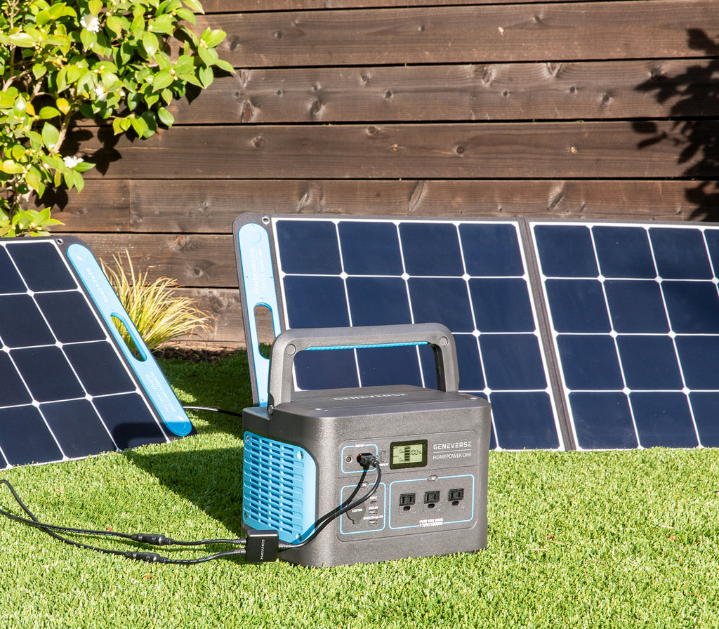 The HomePower ONE portable power station is pictured outdoors with the SolarPower ONE solar panel power station.