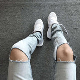 Cut Light Wash Jeans