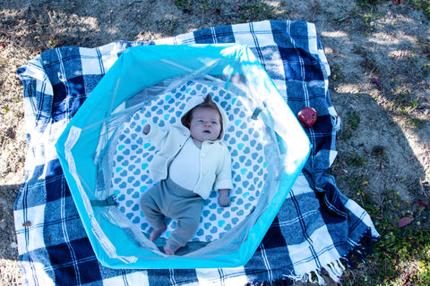my play baby bassinet with a newborn