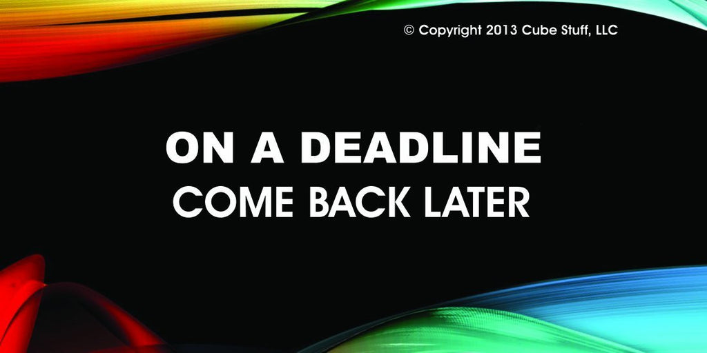 On a Deadline Cube Sign Colored Background
