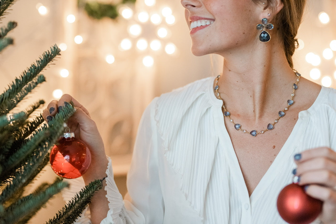 Model with Blue Topaz Earrings and Tanzanite Necklace Holiday lights