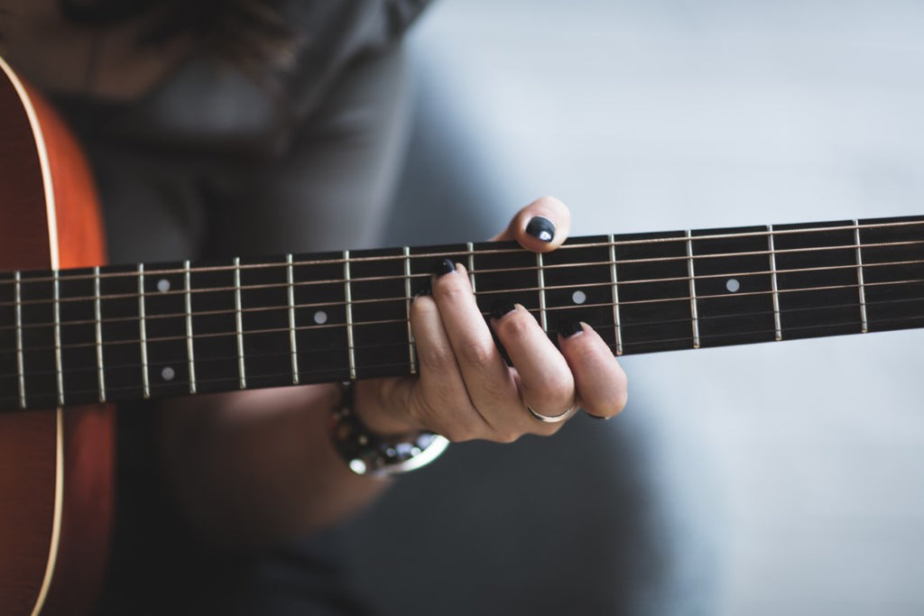 Fingers Making a Chord on Guitar Neck