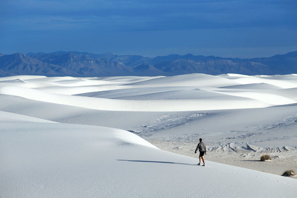 Man Walking On Sand Dunes in White Sands National Park New Mexico
