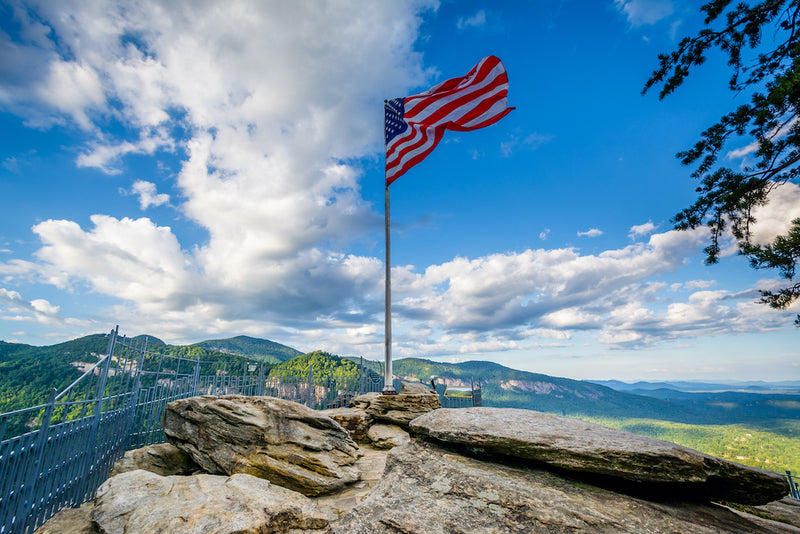 View of American Flag on Top of Chimney Rock at Chimney Rock State Park
