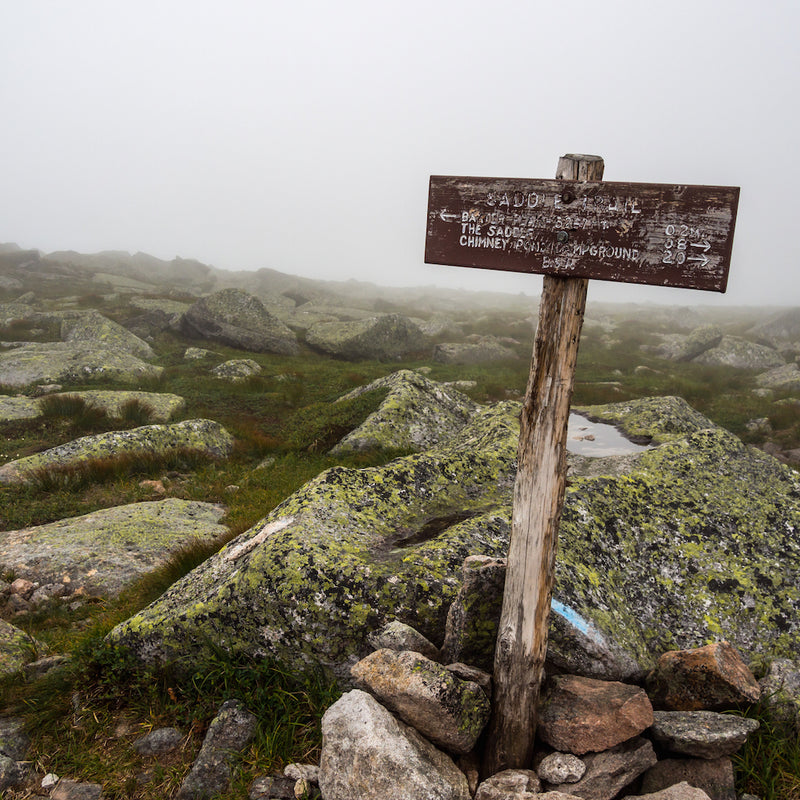 Weathered wooden sign along rocky Katahdin slope in Baxter State Park Maine